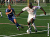 Jay Alberts and Nelson Akwari battle for the ball