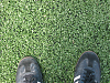 A closeup of the FieldTurf and my Adidas Sambas