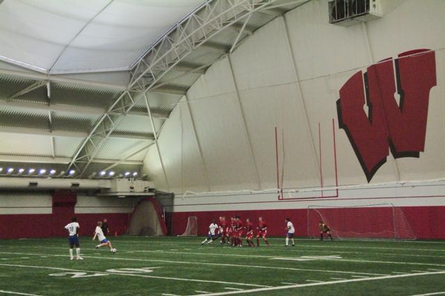 Sasha Gotsmanov takes a free kick at the UW indoor facility in Madison.